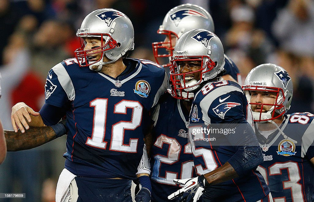 Stevan Ridley #22 of the New England Patriots celebrates his touchdown run with Tom Brady, Brandon Lloyd #85, and Wes Welker #83 of the New England Patriots in the second half against the Houston Texans at Gillette Stadium on December 10, 2012 in Foxboro, Massachusetts.