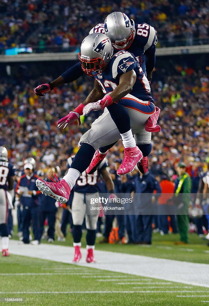 Stevan Ridley #22 of the New England Patriots celebrates with teammate Brandon Lloyd #85 after scoring a touchdown against the Denver Broncos in the second half during the game on October 7, 2012 at Gillette Stadium in Foxboro, Massachusetts.