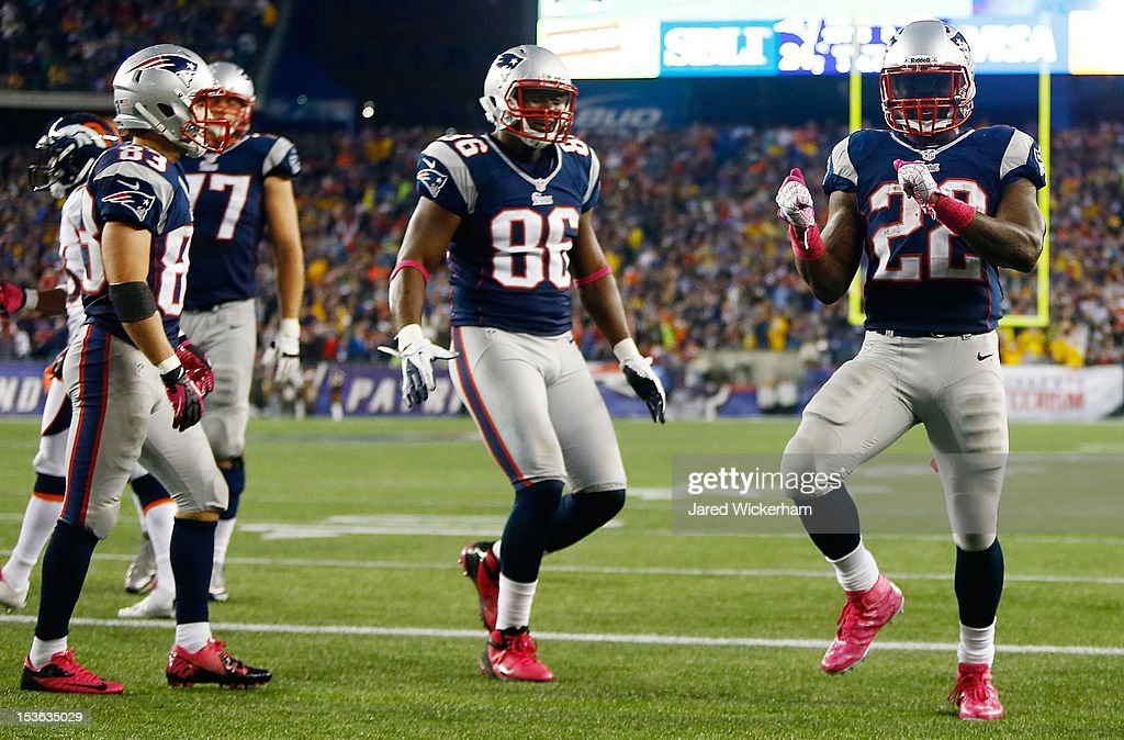 Stevan Ridley #22 of the New England Patriots celebrates with teammates after scoring a touchdown against the Denver Broncos in the second half during the game on October 7, 2012 at Gillette Stadium in Foxboro, Massachusetts.
