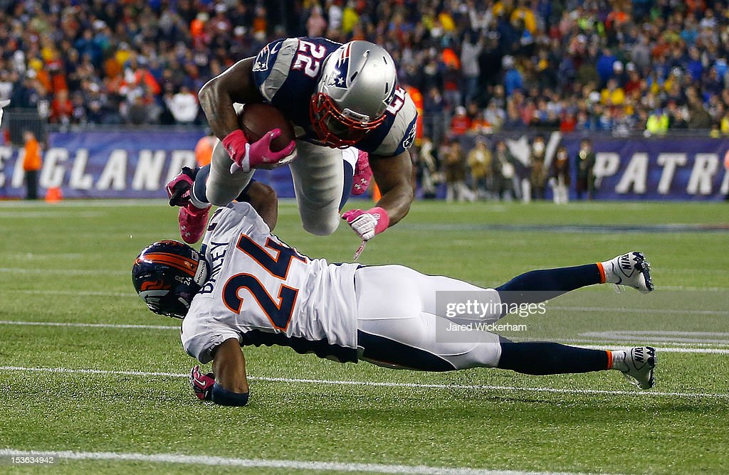 Stevan Ridley #22 of the New England Patriots dives in to score a touchdown over Champ Bailey #24 of the Denver Broncos in the second half during the game on October 7, 2012 at Gillette Stadium in Foxboro, Massachusetts.