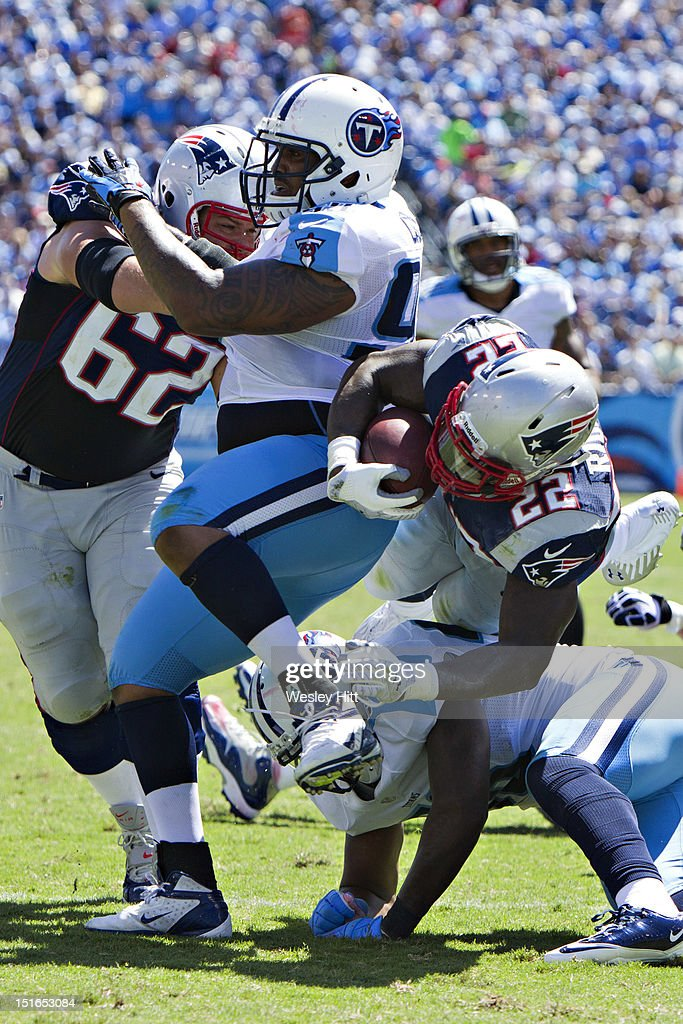 Stevan Ridley #22 of the New England Patriots dives over a tackler during the season opener against the Tennessee Titans at LP Field on September 8, 2012 in Nashville, Tennessee. The Patriots defeated the Titans 34 to 13.