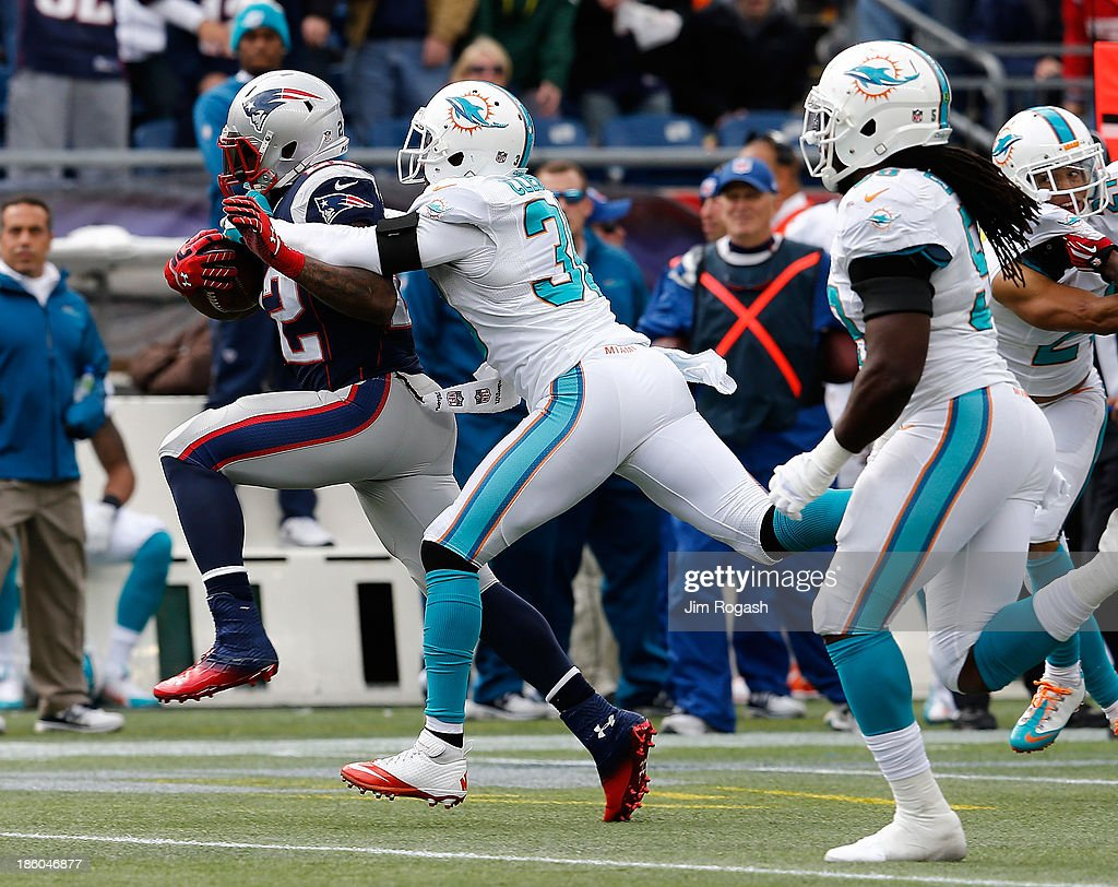 <a gi-track='captionPersonalityLinkClicked' href=/galleries/search?phrase=Stevan+Ridley&family=editorial&specificpeople=4674104 ng-click='$event.stopPropagation()'>Stevan Ridley</a> #22 of the New England Patriots gains yards against the Miami Dolphins in the second half at Gillette Stadium on October 27, 2013 in Foxboro, Massachusetts.