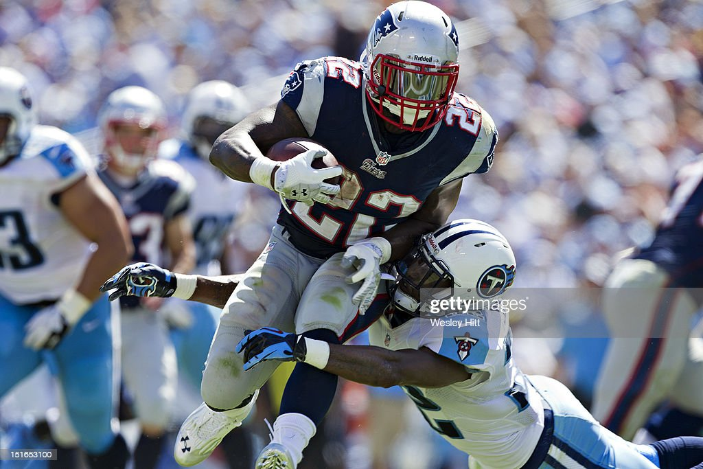 Stevan Ridley #22 of the New England Patriots is tackled by <a gi-track='captionPersonalityLinkClicked' href=/galleries/search?phrase=Robert+Johnson+-+American+Football+Safety+-+Born+1980&family=editorial&specificpeople=13873741 ng-click='$event.stopPropagation()'>Robert Johnson</a> #32 of the Tennessee Titans during the season opener at LP Field on September 8, 2012 in Nashville, Tennessee. The Patriots defeated the Titans 34 to 13.