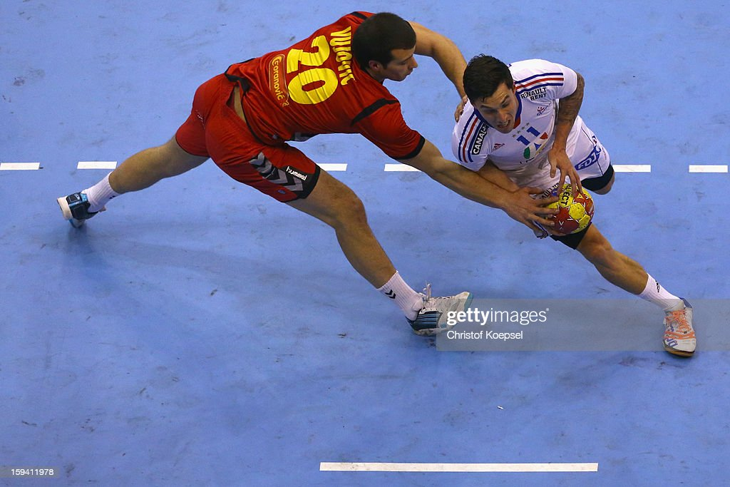 Stevan Vujovic of Montenegro defends against Samuel Honrubia of France during the premilary group A match between Montenegro and France at Palacio de Deportes de Granollers on January 13, 2013 in Granollers, Spain.
