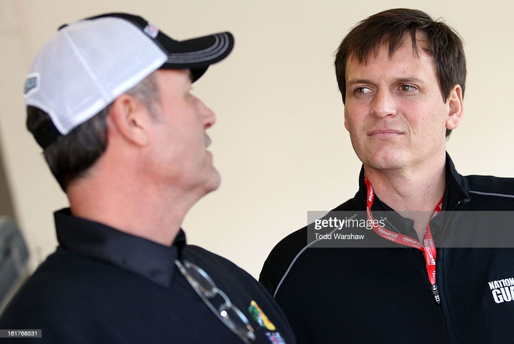 Steve Addington, crew chief of the #14 Mobil 1/Bass Pro Shops Chevrolet speaks with Steve Letarte, crew chief of the #88 National Guard Chevrolet, during practice for the NASCAR Sprint Cup Series Sprint Unlimited at Daytona International Speedway on February 15, 2013 in Daytona Beach, Florida.