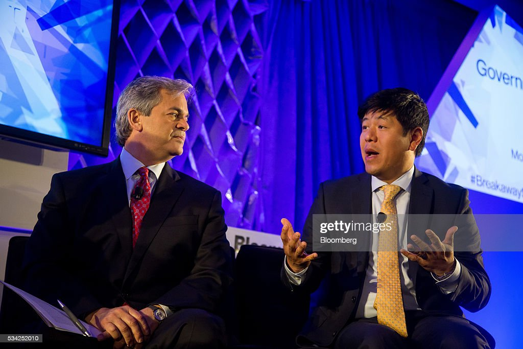 Steve Adler, mayor of Austin, left, listens as Kil Huh, senior director of Pew Charitable Trusts, speaks during the Bloomberg Breakaway Summit in New York, U.S., on Wednesday, May 25, 2016. At the inaugural event, participants will hear from corporate leaders investors and government officials on the most crucial issues that impact their ability to find new markets, win over investors, recruit top talent, protect data, and more. Photographer: Michael Nagle/Bloomberg via Getty Images