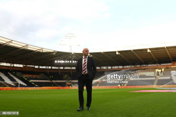 Steve Agnew caretaker manager of Middlesbrough takes a look around the pitch prior to the Premier League match between Hull City and Middlesbrough at...