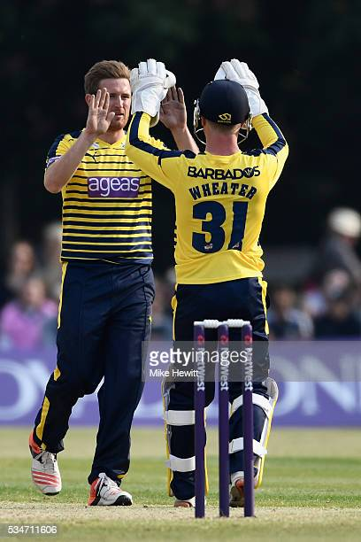 Steve Andrew and wicketkeeper Adam Wheater of Hampshire celebrate the wicket of Adam Voges of Middlesex during the NatWest T20 Blast between...