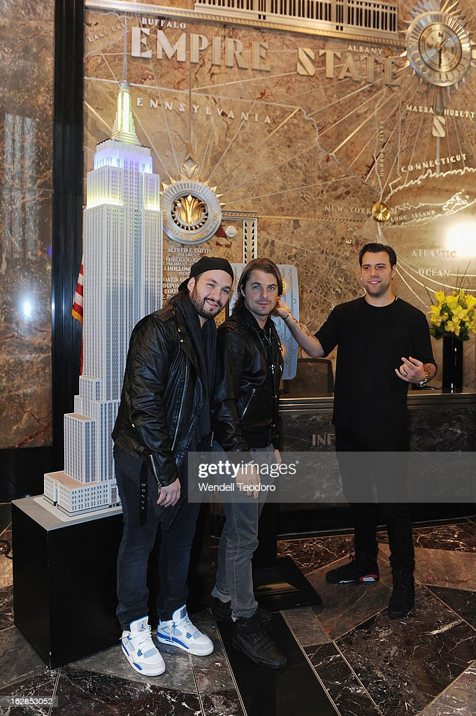 <a gi-track='captionPersonalityLinkClicked' href=/galleries/search?phrase=Steve+Angello&family=editorial&specificpeople=5737645 ng-click='$event.stopPropagation()'>Steve Angello</a>, <a gi-track='captionPersonalityLinkClicked' href=/galleries/search?phrase=Axwell&family=editorial&specificpeople=5989822 ng-click='$event.stopPropagation()'>Axwell</a> and Sebastian Ingrosso of Swedish House Mafia light The Empire State Building on February 28, 2013 in New York City.
