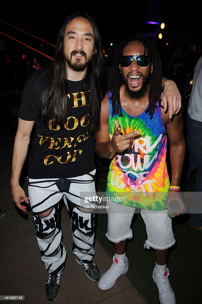 Steve Aok and iLil Jon pose backstage during the iHeartRadio Ultimate Pool Party Presented By VISIT FLORIDA At Fontainebleau's BleauLive at Fontainebleau Miami Beach on June 27, 2014 in Miami Beach, Florida.