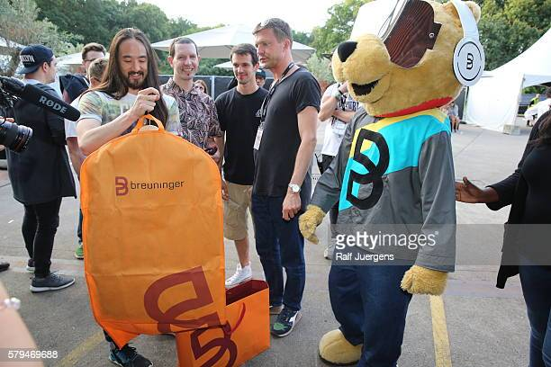 Steve Aoki and BreuniBaer mascot of Breuninger are seen during the ParookaVille Festival on July 15 2016 in Weeze Germany