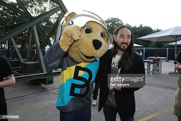 Steve Aoki and BreuniBaer mascot of Breuninger pose for a photograph at the ParookaVille Festival on July 15 2016 in Weeze Germany