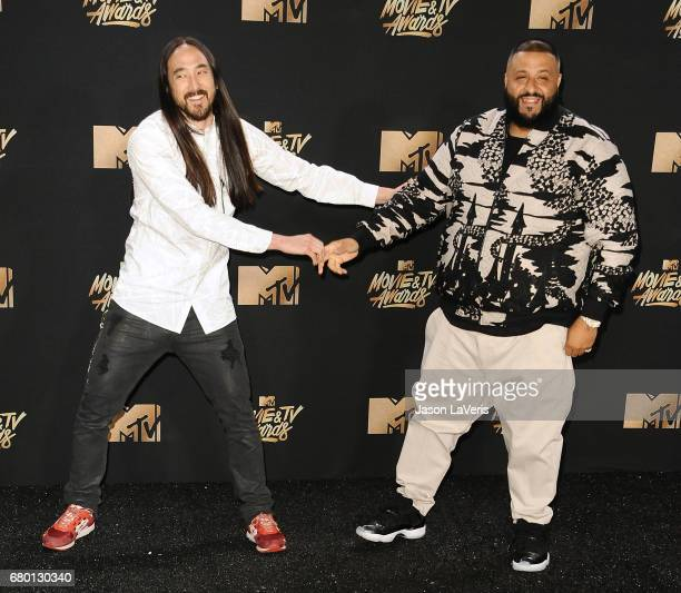Steve Aoki and DJ Khaled pose in the press room at the 2017 MTV Movie and TV Awards at The Shrine Auditorium on May 7 2017 in Los Angeles California