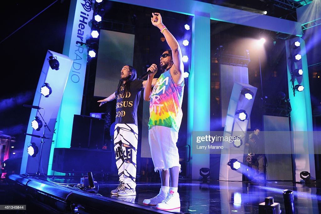 Steve Aoki and Lil Jon perform onstage at the iHeartRadio Ultimate Pool Party presented by VISIT FLORIDA at Fontainebleau's BleauLive at Fontainebleau Miami Beach on June 27, 2014 in Miami Beach, Florida.