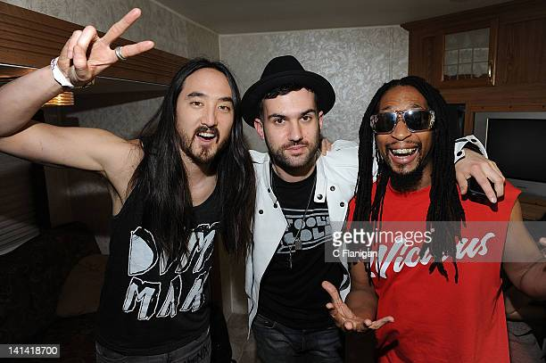 Steve Aoki ATrak and Lil John pose backstage during the 8th Annual MtvU Woodie Awards at SXSW on March 15 2012 in Austin Texas