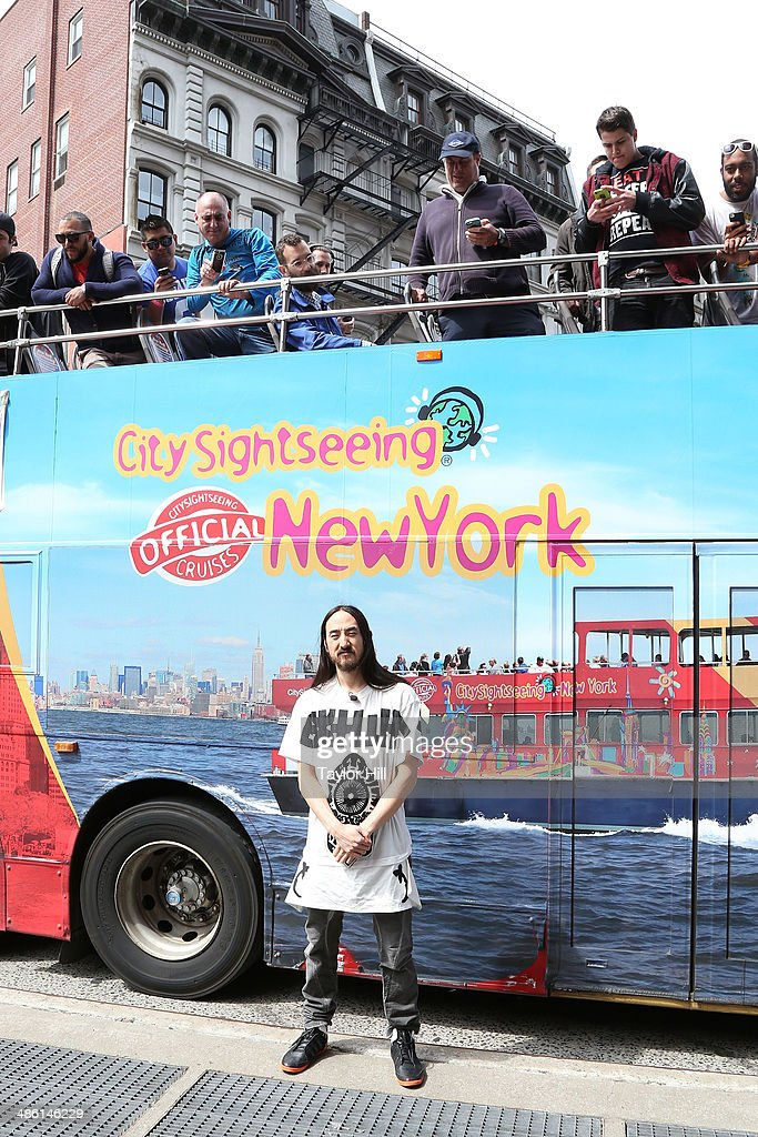 DJ <a gi-track='captionPersonalityLinkClicked' href=/galleries/search?phrase=Steve+Aoki&family=editorial&specificpeople=732001 ng-click='$event.stopPropagation()'>Steve Aoki</a> holds a press gaggle aboard a bus taking them to Madison Square Garden for a press conference on April 22, 2014 in New York City.