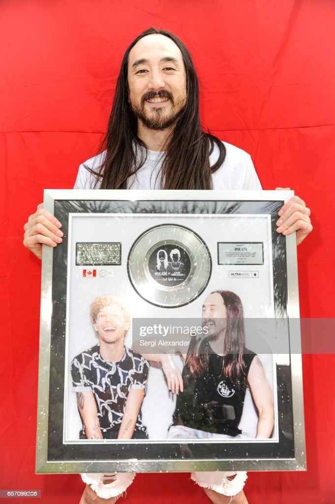 Steve Aoki is presented with a plaque for his single 'Just Hold On' at 1 Hotel & Homes South Beach on March 23, 2017 in Miami Beach, Florida.