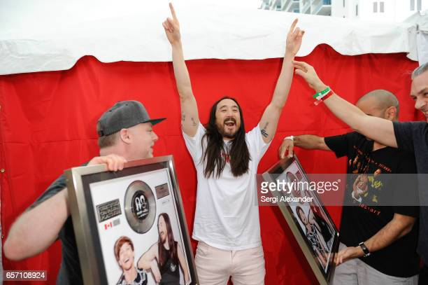 Steve Aoki is presented with a plaque for his single 'Just Hold On' at 1 Hotel Homes South Beach on March 23 2017 in Miami Beach Florida