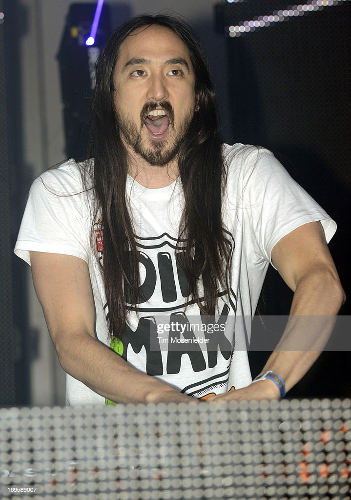 <a gi-track='captionPersonalityLinkClicked' href=/galleries/search?phrase=Steve+Aoki&family=editorial&specificpeople=732001 ng-click='$event.stopPropagation()'>Steve Aoki</a> performs as part of Day 4 of the Sasquatch! Music Festival at the Gorge Amphitheatre on May 27, 2013 in George, Washington.
