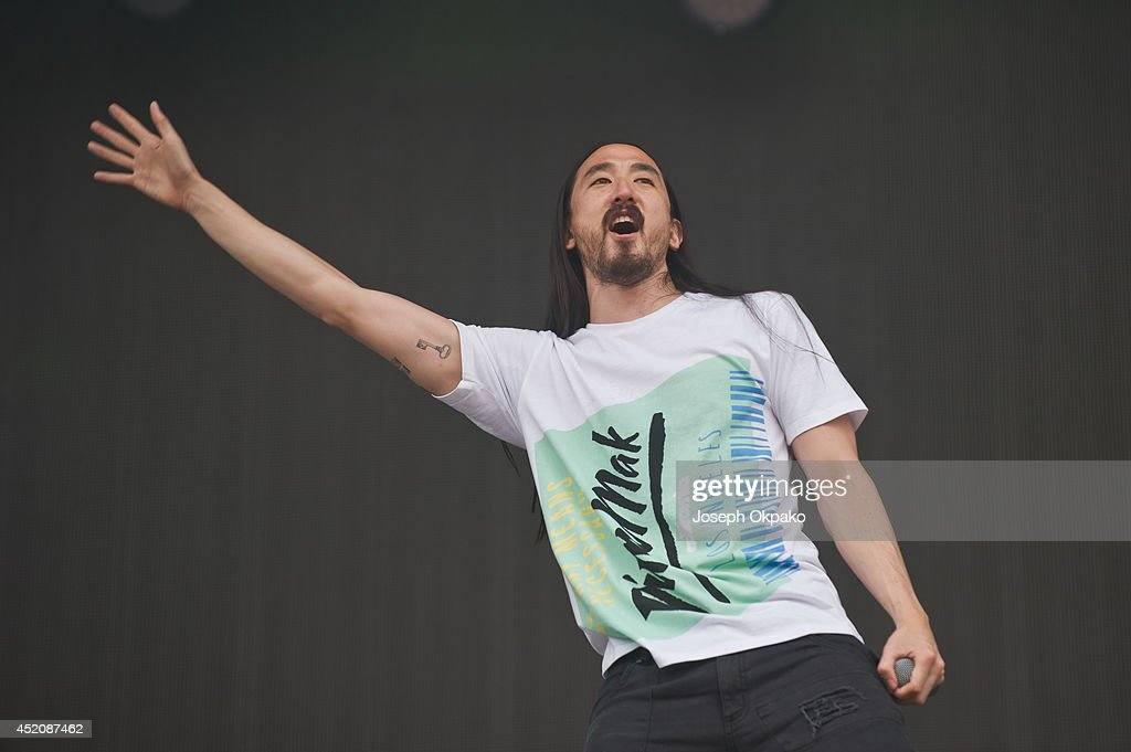 Steve Aoki performs on stage during the Electric Daisy Carnival 2014 on July 12, 2014 in Milton Keynes, England.