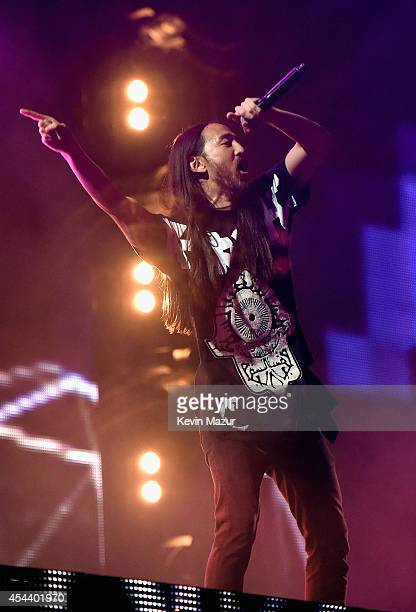 Steve Aoki performs onstage at the 2014 Budweiser Made In America Festival at Benjamin Franklin Parkway on August 30 2014 in Philadelphia Pennsylvania