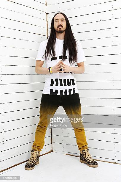 Steve Aoki poses for a portrait backstage at The Fader Fort presented by Converse during SXSW on March 13 2014 in Austin Texas