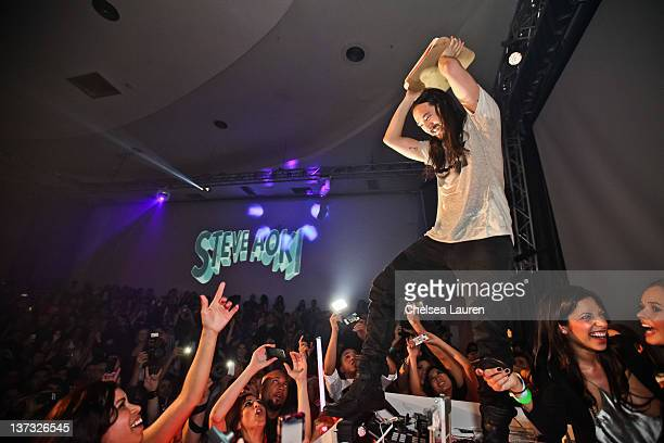 Steve Aoki prepares to throw a cake at a fan at his record release event celebrating 'Wonderland' at SupperClub Los Angeles on January 18 2012 in Los...