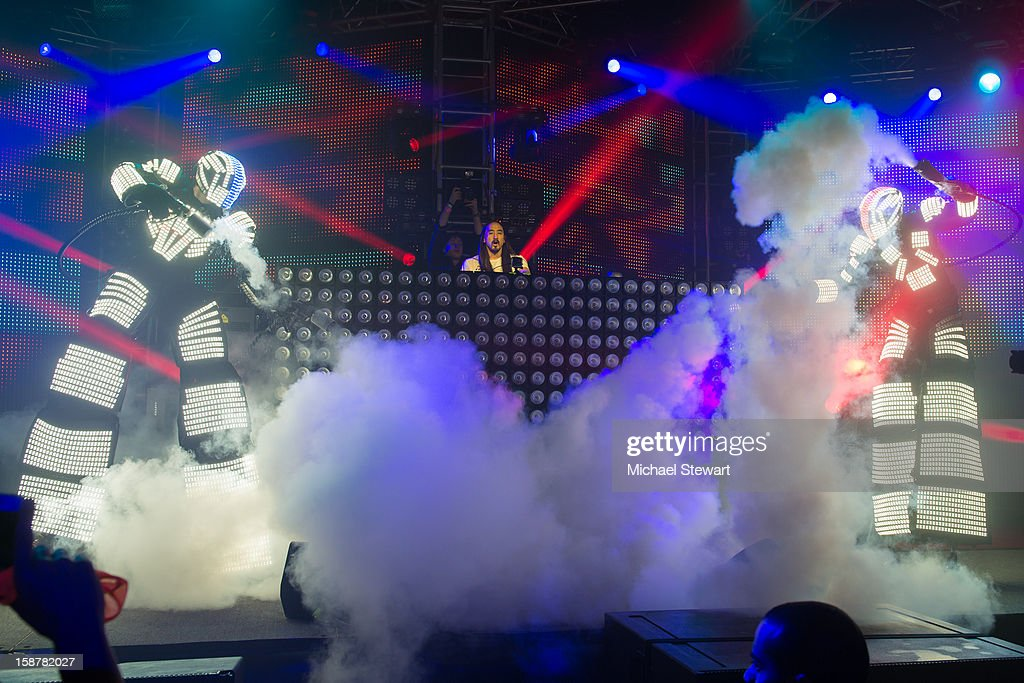 DJ Steve Aoki (C) with Kryomen perform during 2012 Aokify NYC at Pier 94 on December 27, 2012 in New York City.