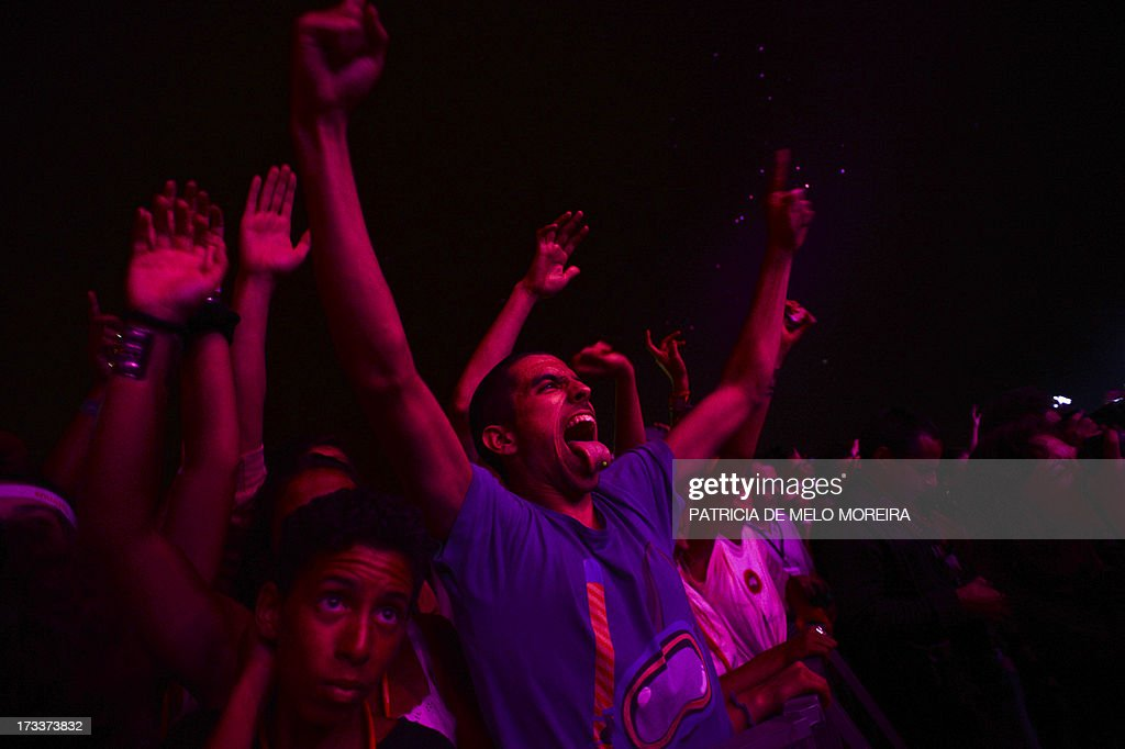 Steve Aoki's fans dance during his performance at the Optimus Alive music festival at Alges, in the outskirts of Lisbon, on July 12, 2013. The Optimus Alive music festival runs from July 12 to July 14. AFP PHOTO/ PATRICIA DE MELO MOREIRA