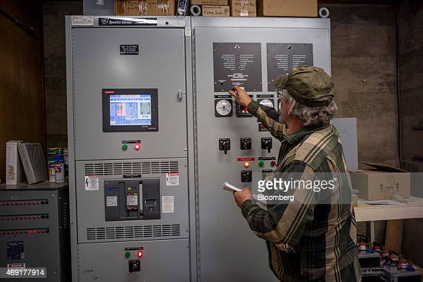 Steve Atkins checks gauges on a control panel at the Tunnel Hill Hydro LLC hydroelectric power station in Georgetown California US on Thursday April...