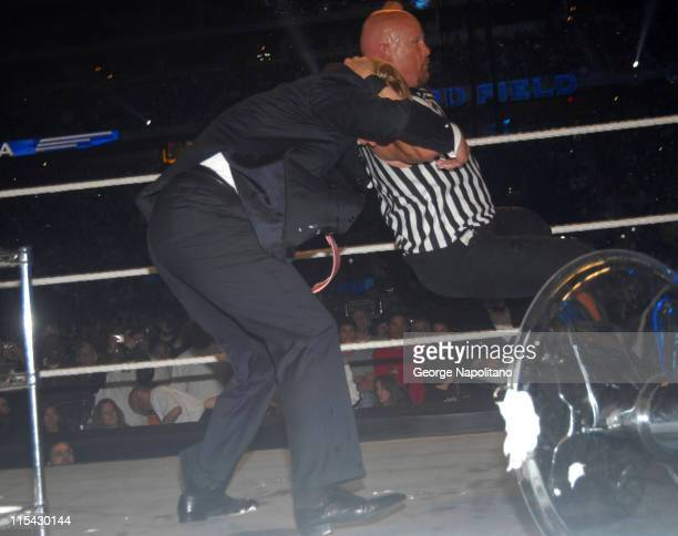 Steve austin catches Donald Trump in his Stone Cold Stunner after they celebrated Vince McHaon's head getting shaved at Wrestlemania 23 in Detroit
