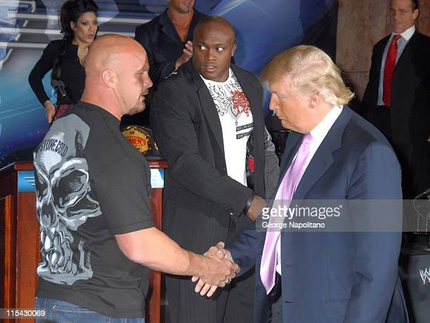 Steve Austin shakes hands with Donald Trump during Donald Trump and WWE News Conference for WrestleMania 23 at Trump Tower in New York City New York...