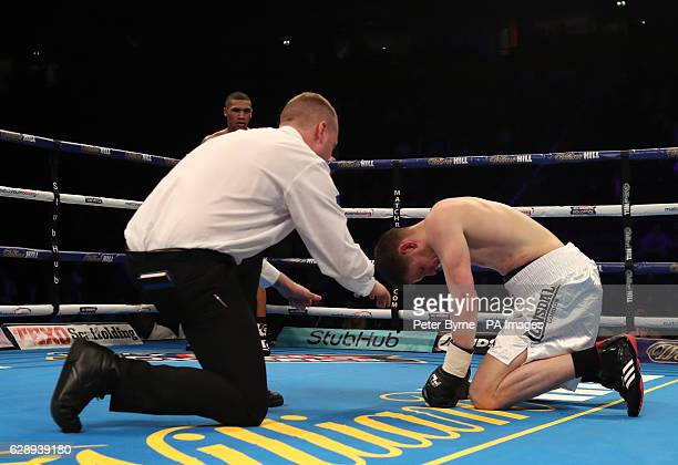 Steve Backhouse is counted out after being knocked down by Conor Benn during their Welterweight bout at the Manchester Arena