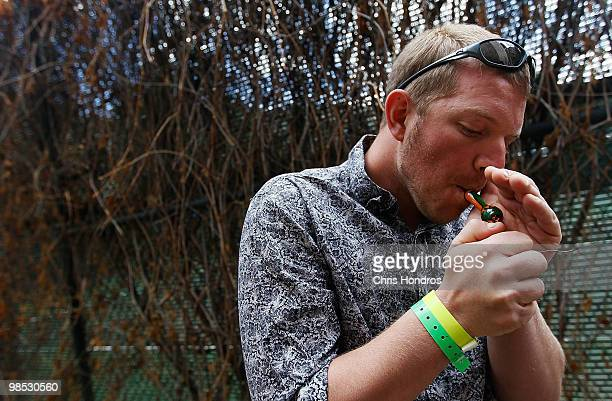 Steve Ball of Denver Colorado evaluates some marijuana submitted to a competition at the Cannabis Crown 2010 expo in Aspen Colorado Cannabis Crown...