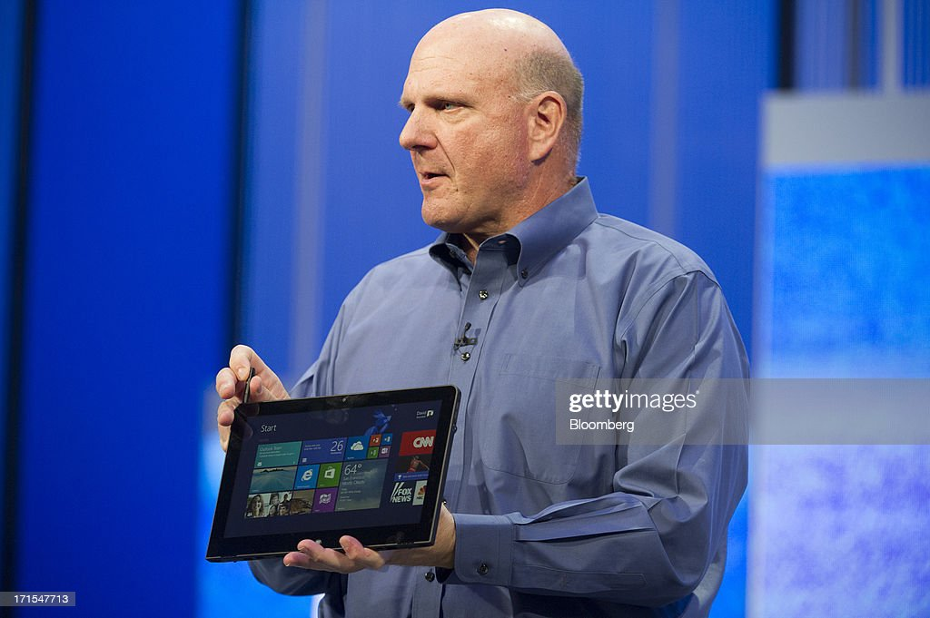 Steve Ballmer, chief executive officer of Microsoft Corp., holds up a Lenovo Group Ltd. computer tablet while delivering the keynote during the Microsoft Build Developers Conference in San Francisco, California, U.S., on Wednesday, June 26, 2013. Facebook Inc. is building an application for Microsoft Corp.'s Windows 8, adding one of the most popular programs still missing from the operating system designed to help Microsoft gain tablet customers. Photographer: David Paul Morris/Bloomberg via Getty Images