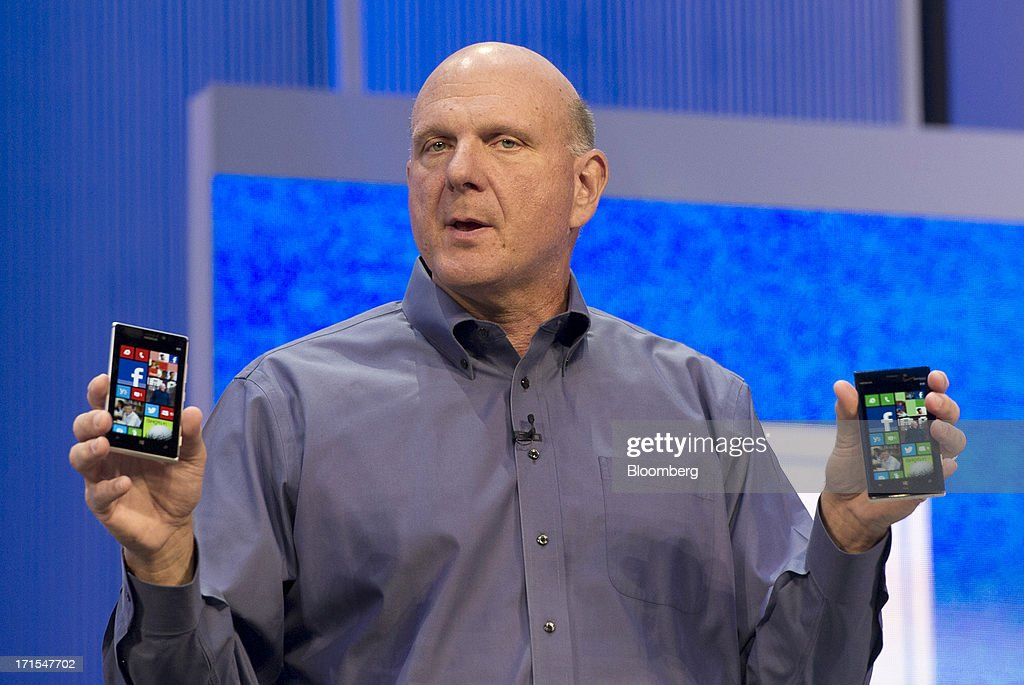 Steve Ballmer, chief executive officer of Microsoft Corp., holds up Nokia OYJ smart phones while delivering the keynote during the Microsoft Build Developers Conference in San Francisco, California, U.S., on Wednesday, June 26, 2013. Facebook Inc. is building an application for Microsoft Corp.'s Windows 8, adding one of the most popular programs still missing from the operating system designed to help Microsoft gain tablet customers. Photographer: David Paul Morris/Bloomberg via Getty Images