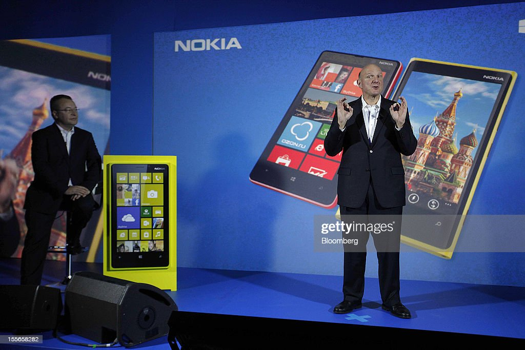 Steve Ballmer, chief executive officer of Microsoft Corp., right, speaks while Stephen Elop, chief executive officer of Nokia Oyj, listens during a presentation of the new Nokia Lumia 920 smartphone at a news conference in Moscow, Russia, on Tuesday, Nov. 6, 2012. Microsoft is considering building mobile hardware as a backup, in the event that its current approach of providing software to handset makers such as Nokia Oyj and HTC Corp. falters, said the people, who requested anonymity because the plans are private. Photographer: Alexander Zemlianichenko Jr./Bloomberg via Getty Images