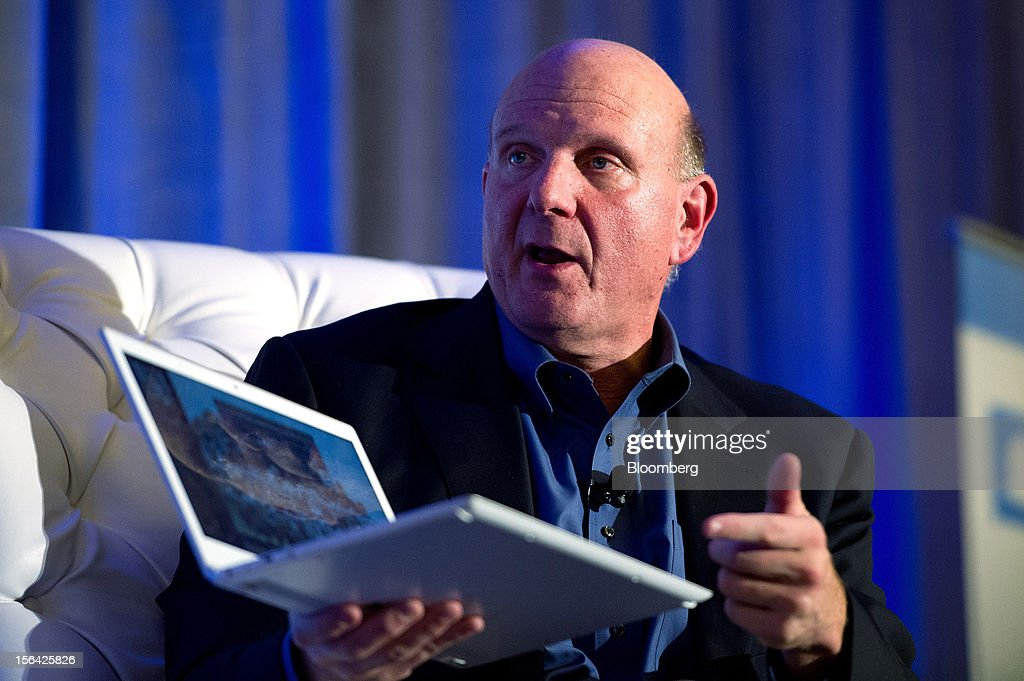 Steve Ballmer, chief executive officer of Microsoft Corp., speaks as he holds a Samsung laptop computer running Windows 8 software during an event at the Churchill Club in Santa Clara, California, U.S., on Wednesday, Nov. 14, 2012. Microsoft Corp's Ballmer said the maker of Windows programs must exploit the opportunity to combine hardware and software as it challenges Apple Inc.'s iPad with the Surface tablet computer. Photographer: David Paul Morris/Bloomberg via Getty Images