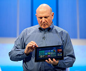 Steve Ballmer chief executive officer of Microsoft holds up a Lenovo computer tablet while delivering a keynote address to the crowd at the Microsoft...