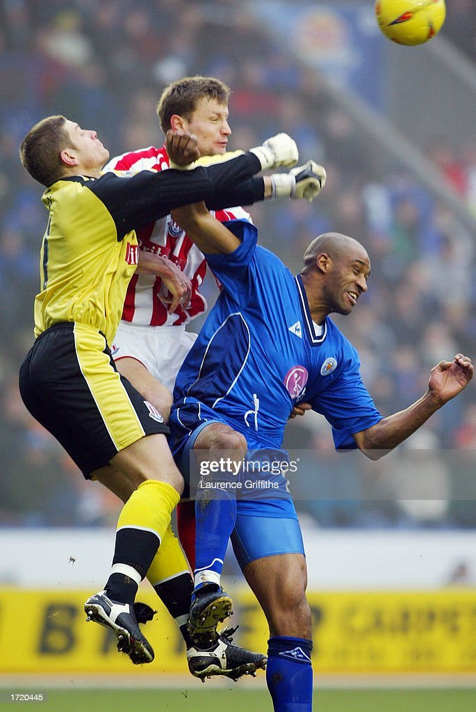 Steve Banks of Stoke punches clear from Brian Deane of Leicester City during the Nationwide First Division match between Leicester City and Stoke City on January 11, 2003 at the Walkers Stadium, Leicester, England.