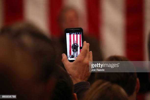Steve Bannon is seen on the screen of an iPhone as he speaks before the arrival of Republican Senatorial candidate Roy Moore during a campaign event...