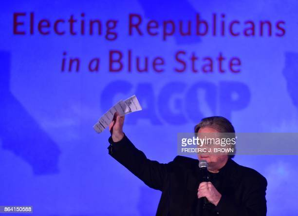 Steve Bannon waves to the audience after addressing the California GOP 2017 Convention in Anaheim California on October 20 2017 Bannon the architect...