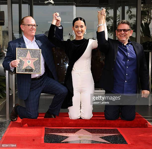Steve Barnett Chairman Chief Operating Officer Capitol Music Group singer Katy Perry and Sir Lucian Grainge Chairman Chief Executive Officer of...