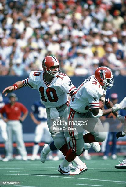 Steve Bartkowski of the Atlanta Falcons hands the ball off to William Andrews against the New York Giants during an NFL football game September 12...