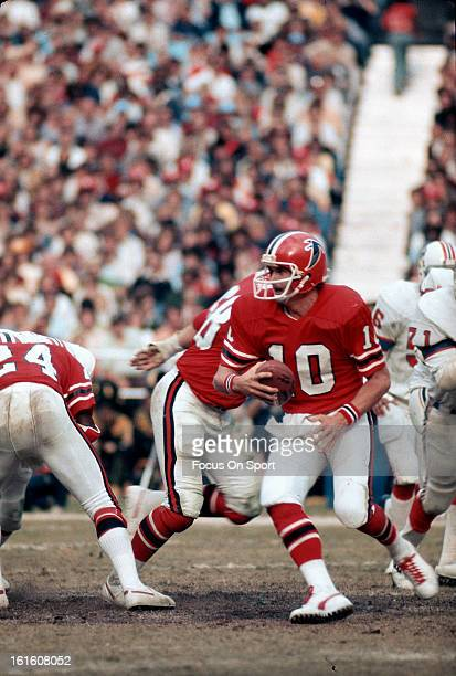 Steve Bartkowski of the Atlanta Falcons scrambles with the ball against the New England Patriots during an NFL football game December 4 1977 at...