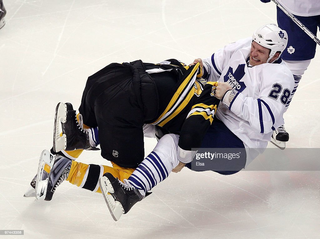 <a gi-track='captionPersonalityLinkClicked' href=/galleries/search?phrase=Steve+Begin&family=editorial&specificpeople=212983 ng-click='$event.stopPropagation()'>Steve Begin</a> #27 of the Boston Bruins tackles <a gi-track='captionPersonalityLinkClicked' href=/galleries/search?phrase=Colton+Orr&family=editorial&specificpeople=581689 ng-click='$event.stopPropagation()'>Colton Orr</a> #28 of the Toronto Maple Leafs in the third period on March 4, 2010 at the TD Garden in Boston, Massachusetts.