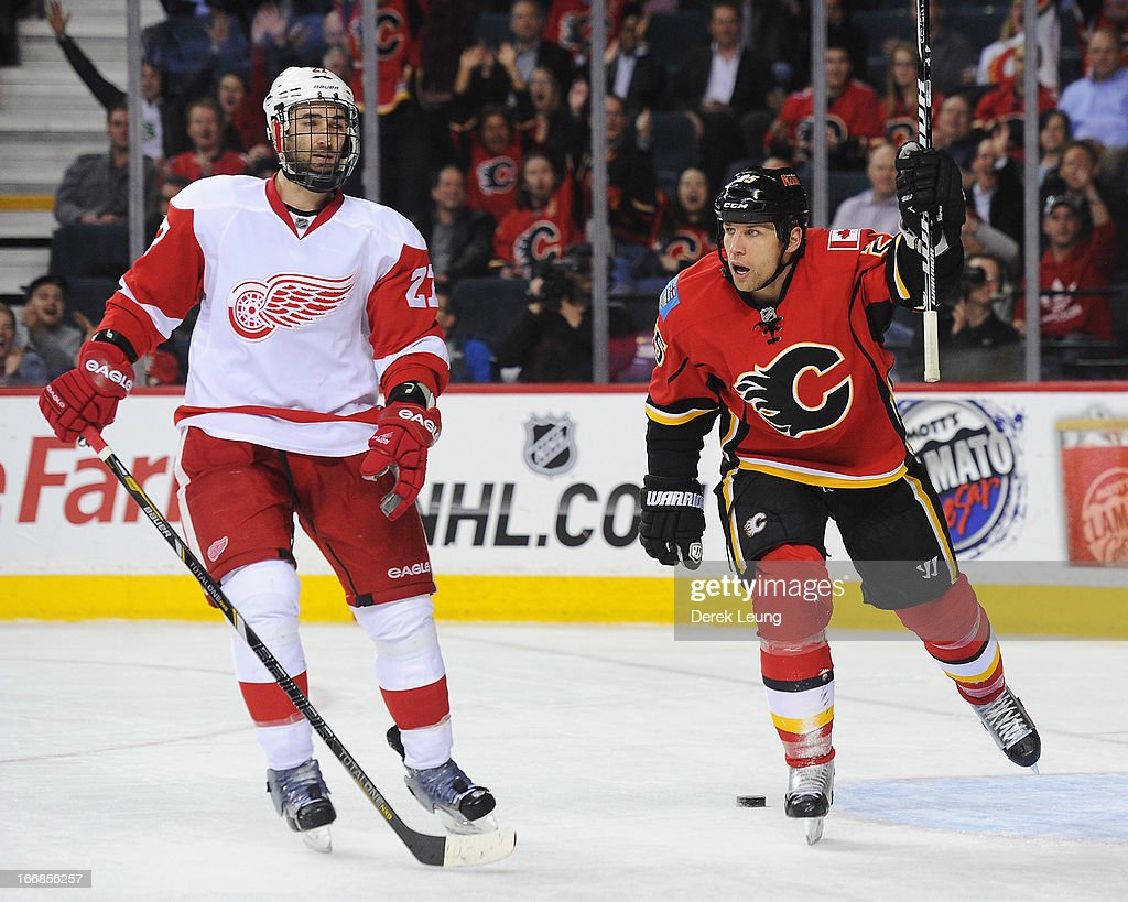<a gi-track='captionPersonalityLinkClicked' href=/galleries/search?phrase=Steve+Begin&family=editorial&specificpeople=212983 ng-click='$event.stopPropagation()'>Steve Begin</a> #25 of the Calgary Flames celebrates an empty net goal in front of a dejected <a gi-track='captionPersonalityLinkClicked' href=/galleries/search?phrase=Kyle+Quincey&family=editorial&specificpeople=2234340 ng-click='$event.stopPropagation()'>Kyle Quincey</a> #27 of the Detroit Red Wings during an NHL game at Scotiabank Saddledome on April 17, 2013 in Calgary, Alberta, Canada.
