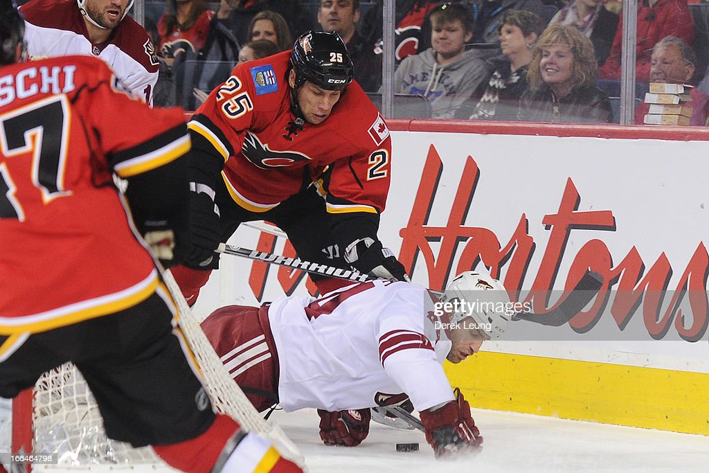 <a gi-track='captionPersonalityLinkClicked' href=/galleries/search?phrase=Steve+Begin&family=editorial&specificpeople=212983 ng-click='$event.stopPropagation()'>Steve Begin</a> #25 of the Calgary Flames checks <a gi-track='captionPersonalityLinkClicked' href=/galleries/search?phrase=Kyle+Chipchura&family=editorial&specificpeople=879784 ng-click='$event.stopPropagation()'>Kyle Chipchura</a> #24 of the Phoenix Coyotes during an NHL game at Scotiabank Saddledome on April 12, 2013 in Calgary, Alberta, Canada.