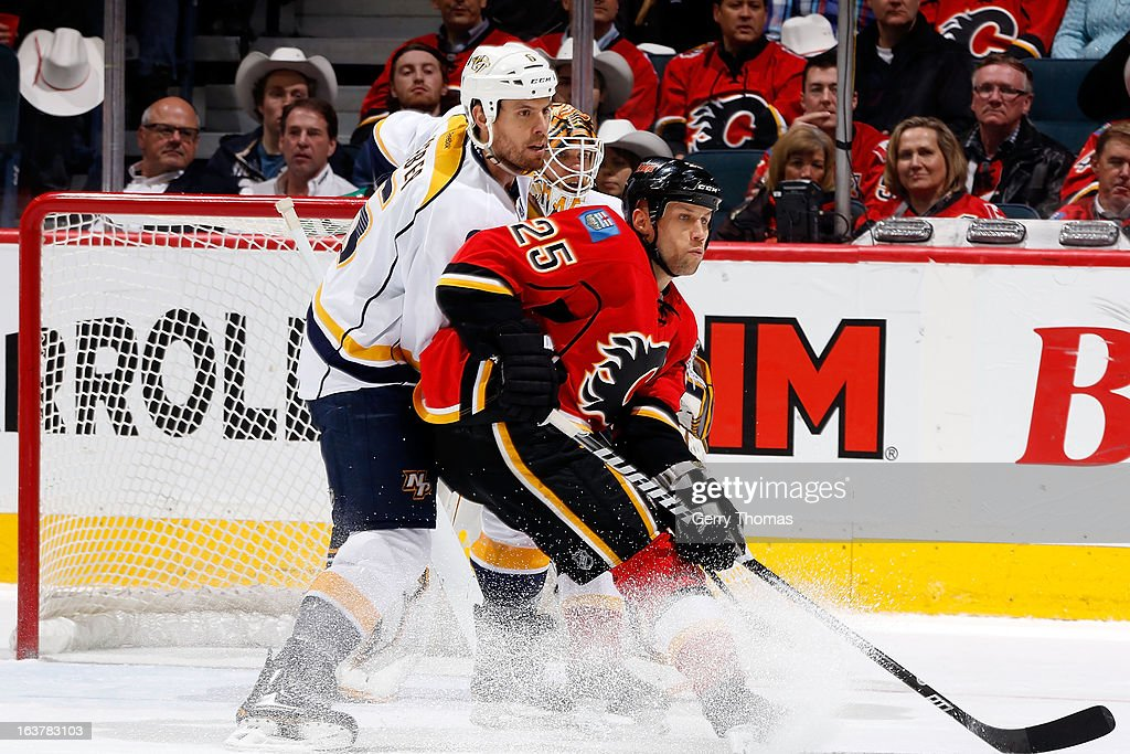 <a gi-track='captionPersonalityLinkClicked' href=/galleries/search?phrase=Steve+Begin&family=editorial&specificpeople=212983 ng-click='$event.stopPropagation()'>Steve Begin</a> #25 of the Calgary Flames skates against <a gi-track='captionPersonalityLinkClicked' href=/galleries/search?phrase=Shea+Weber&family=editorial&specificpeople=554412 ng-click='$event.stopPropagation()'>Shea Weber</a> #6 of the Nashville Predators on March 15, 2013 at the Scotiabank Saddledome in Calgary, Alberta, Canada.