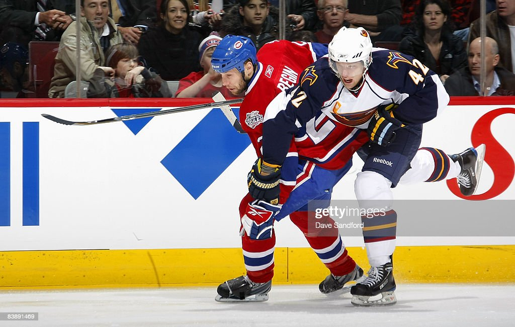 Steve Begin of the Montreal Canadiens battles for position with Joey Crabb of the Atlanta Thrashers during their NHL game at the Bell Centre December...